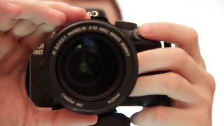 Photographers work. DSLR Camera (Digital single-lens reflex camera). Focusing