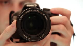 Photographers work. DSLR Camera (Digital single-lens reflex camera). Shooting