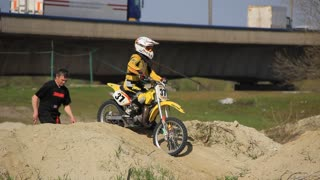 Professional motorcyclist on racing motorcycle