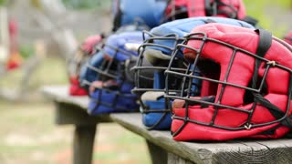 Red and blue protective helmets