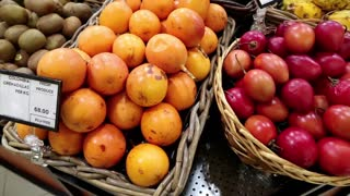 Red and yellow fresh exotic fruits in supermarket. Shop counter with fresh exotic fruits. Yellow colombia grenadillas