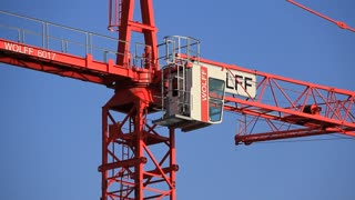 Red building crane on blue background