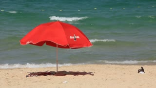 Red umbrella on the beach