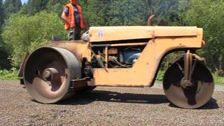 Road roller going on the new asphalt