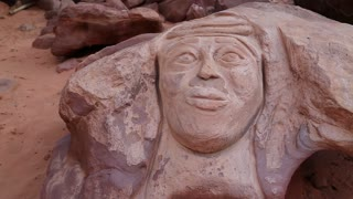 Rock carving of the head of Lawrence of Arabia in Wadi Rum desert in Jordan. Wadi Rum, also known as Valley of Moon, is the largest wadi in Jordan, that consists of sand, sandstone and granite rocks