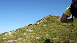 Run uphill. Man run on green mountain