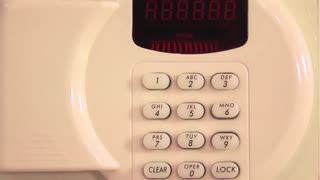 Safe combination numeric keypad with red buttons