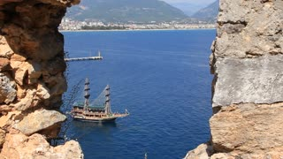 Sea craft in Alanya, Turkey. Ruins of old fortress wall Alanya, Turkey