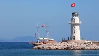 Ship and white lighthouse. Voyage. Alanya, Turkey
