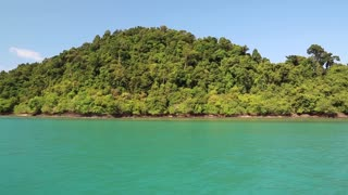 Ship sails along beautiful islands in Gulf of Siam in Thailand