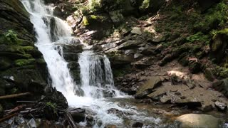 Shypit waterfall (English translation - Sizzle) is located on the Pylypets River, about 6 kilometres from the Pylypets village, Mizhhiria region, Carpathian Mountains. The waterfall is 14 metres high