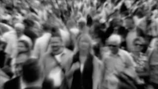 Slow motion: Crowd of people. Monochrome version with blur