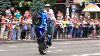 Slow motion: Professional motorcyclist on racing motorcycle