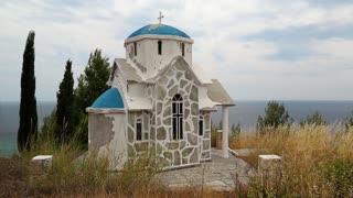 Small Greek temple on the hill near the Aegean Sea