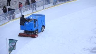 Snow fighter on skating-rink