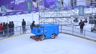 Snow-fighting vehicle on skating-rink