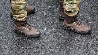 Soldiers in military uniform. Feet of soldiers. Servicemen at the military parade