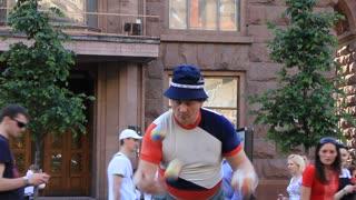 Street juggler with balls