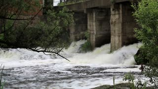 Strong water flow under the bridge