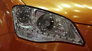 Stylish headlight of a yellow car