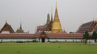 Temple of the Emerald Buddha in Bangkok, Thailand. Wat Phra Kaew or Wat Phra Si Rattana Satsadaram or Temple of the Emerald Buddha in Bangkok is regarded as the most sacred Buddhist temple in Thailand