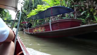 THAILAND, BANGKOK, APRIL 05, 2014: Boat sailing to the floating market Eastern Venice in Bangkok, Thailand