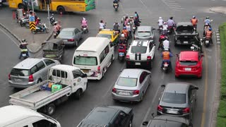 THAILAND, BANGKOK, APRIL 11, 2014: Road traffic near Victory Monument in Bangkok, Thailand. Many cars on the crossroads