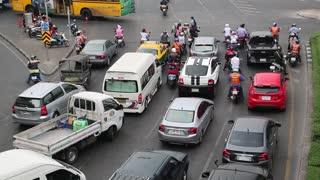 THAILAND, BANGKOK, APRIL 11, 2014: Road traffic near Victory Monument in Bangkok, Thailand. Many cars on the crossroads