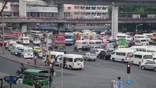 THAILAND, BANGKOK, APRIL 11, 2014: Road traffic near Victory Monument in Bangkok, Thailand