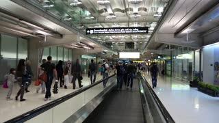 THAILAND, BANGKOK, MARCH 30, 2014: People on travelator inside Bangkok international airport in Thailand