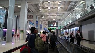 THAILAND, BANGKOK, MARCH 30, 2014: People on travelator inside international airport in Bangkok, Thailand