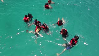 THAILAND, GULF OF SIAM, NEAR KOH CHANG ISLAND, APRIL 8, 2014: Snorkelers swimming in the Gulf of Siam in Thailand