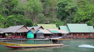THAILAND, KANCHANABURI PROVINCE, APRIL 5, 2014: Bungalows on the Kwai river, also known as the Si Sawat river or Khwae Yai river, near Bangkok in northwestern Thailand
