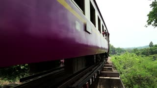 THAILAND, KANCHANABURI PROVINCE, APRIL 5, 2014: People and train on old railroad near Kwai river in Thailand
