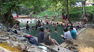 THAILAND, KANCHANABURI PROVINCE, APRIL 5, 2014: People in radon pool in Kanchanaburi Province, western Thailand