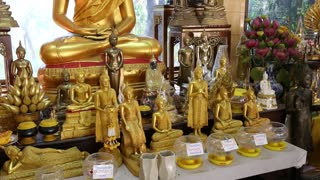 THAILAND, PATTAYA, APRIL 1, 2014: Golden Buddha statues inside Buddhist temple on Pratumnak Hill in Pattaya, Thailand