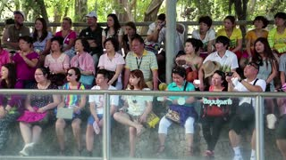 THAILAND, PATTAYA, APRIL 1, 2014: Multiethnic spectators at crocodile show in Pattaya, Thailand