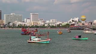 THAILAND, PATTAYA, APRIL 12, 2014: Boats in Pattaya bay, Gulf of Siam, Thailand