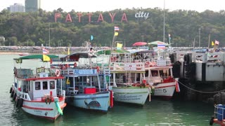 THAILAND, PATTAYA, APRIL 12, 2014: Boats near Pattaya bay, Gulf of Siam, Thailand