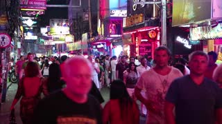 THAILAND, PATTAYA, MARCH 31, 2014: Walking Street is red-light district with many restaurants, go-go bars and brothels, that draws people, primarily for night life and sexual entertainments.