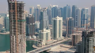 Time Lapse 1080p: Development of Dubai Marina in United Arab Emirates. Dubai Marina (United arab emirates) - the largest man-made marina in the world. Dubai Marina - is a district in the heart of what has become known as New Dubai