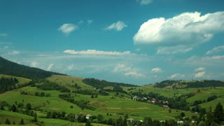 Time lapse of clouds and beautiful green fields. Video without birds and defects