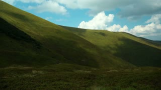 Time lapse of clouds and beautiful green mountains. Video without birds and defects