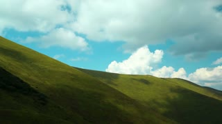 Time lapse of clouds in beautiful green mountains. Video without birds and defects
