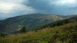 Time lapse of rainclouds in mountains. Video without birds and defects