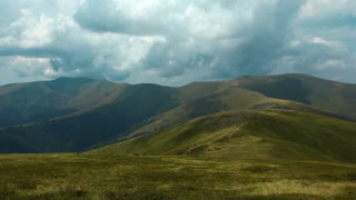Time lapse of storm clouds in mountains. Video without birds and defects
