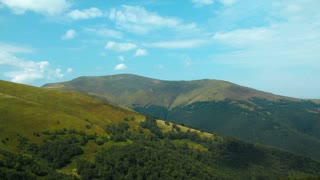Timelapse of clouds in beautiful green mountains. Timelapse without birds and defects