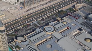 Top view on Dubai Mall and roadway from 124th floor of Burj Khalifa megatall skyscraper in Dubai, United Arab Emirates