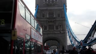 Tower Bridge in London is a combined bascule and suspension bridge over the Thames river . It is close to the Tower of London, from which it takes its name. It has become an iconic symbol of London.