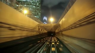 Train drives into a tunnel. The Dubai Metro is a driverless, fully automated metro network. The view through the front window. Dubai is a city and emirate in United Arab Emirates